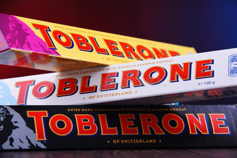 Three bars of Toblerone chocolate. POZNAN, POL - MAR 22, 2019: Three bars of Toblerone, a Swiss chocolate brand owned by US confectionery company Mondelez stock photo