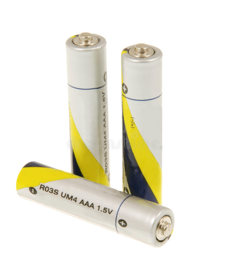 Three batteries. On a white background stock photography
