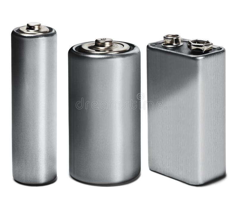 Three batteries AAA, AA and PP3 on white isolated background. Concept of renewable energy and sources of electrical power. Pattern. For designer of stock photo