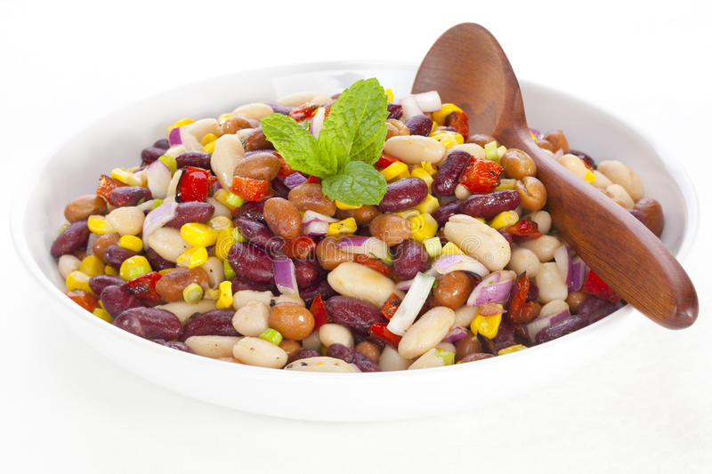 Three Bean Salad. With sweetcorn, roasted red peppers and red onion in a vinaigrette dresing stock photos
