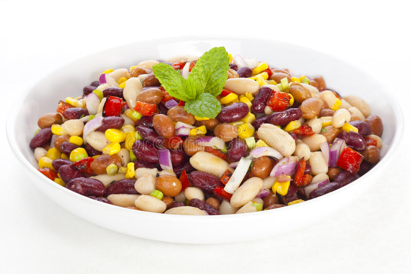 Three Bean Salad. With sweetcorn, roasted red peppers and red onion in a vinaigrette dresing stock images