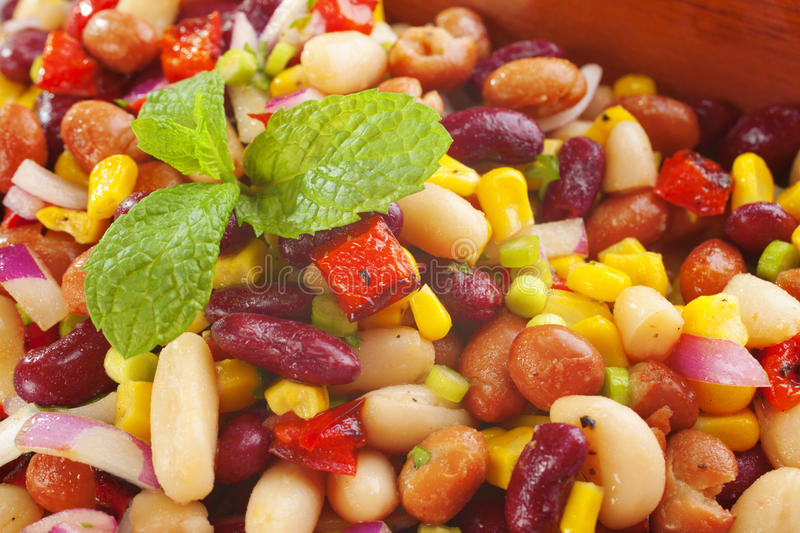Three Bean Salad. With sweetcorn, roasted red peppers and red onion in a vinaigrette dresing stock image