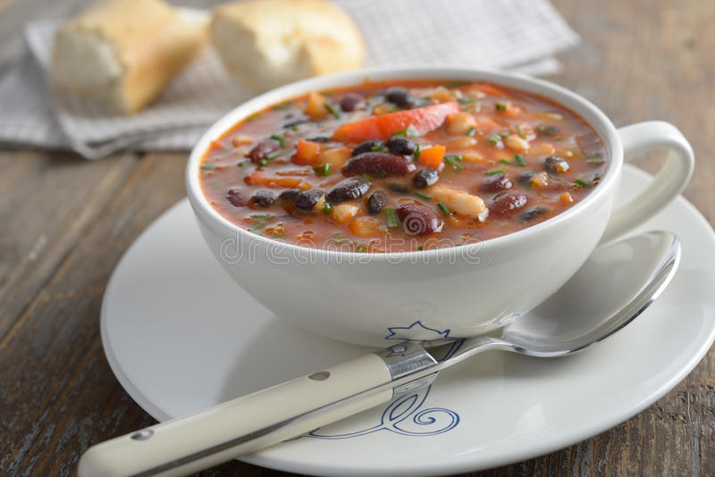 Three bean soup. On a rustic table stock photos