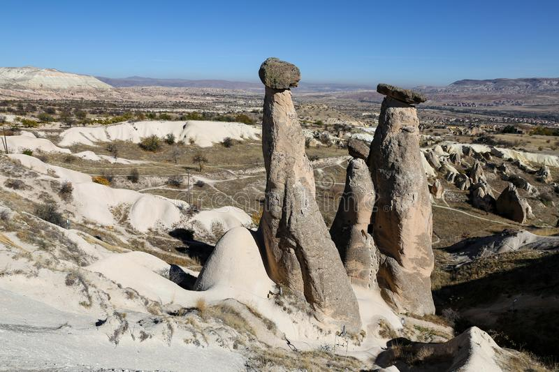 Three Beauties Fairy Chimneys in Urgup Town, Cappadocia, Nevsehir, Turkey. Three Beauties Fairy Chimneys in Urgup Town, Cappadocia, Nevsehir City, Turkey stock images