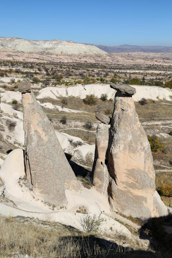 Three Beauties Fairy Chimneys in Urgup Town, Cappadocia, Nevsehir, Turkey. Three Beauties Fairy Chimneys in Urgup Town, Cappadocia, Nevsehir City, Turkey royalty free stock image