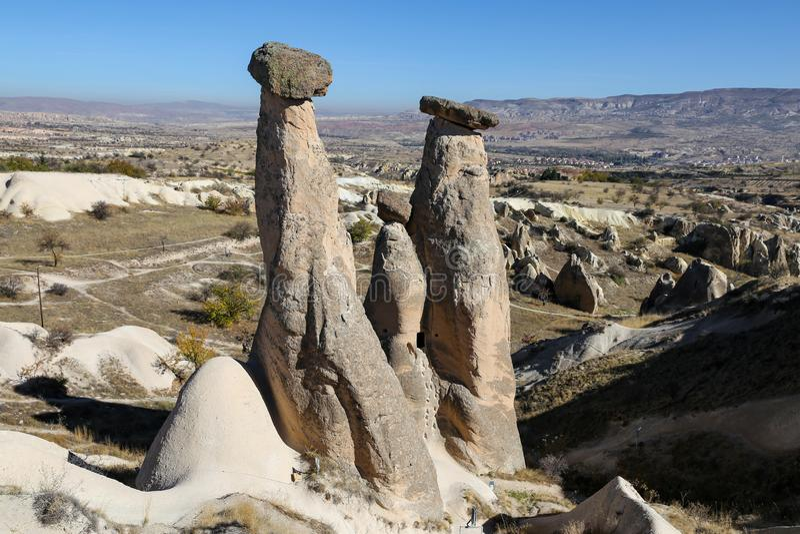 Three Beauties Fairy Chimneys in Urgup Town, Cappadocia, Nevsehir, Turkey. Three Beauties Fairy Chimneys in Urgup Town, Cappadocia, Nevsehir City, Turkey royalty free stock photo
