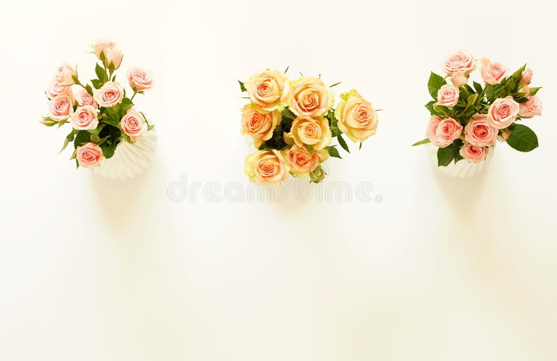 Three Beautiful Bouquets Of Pink And Cream Roses In White Vases