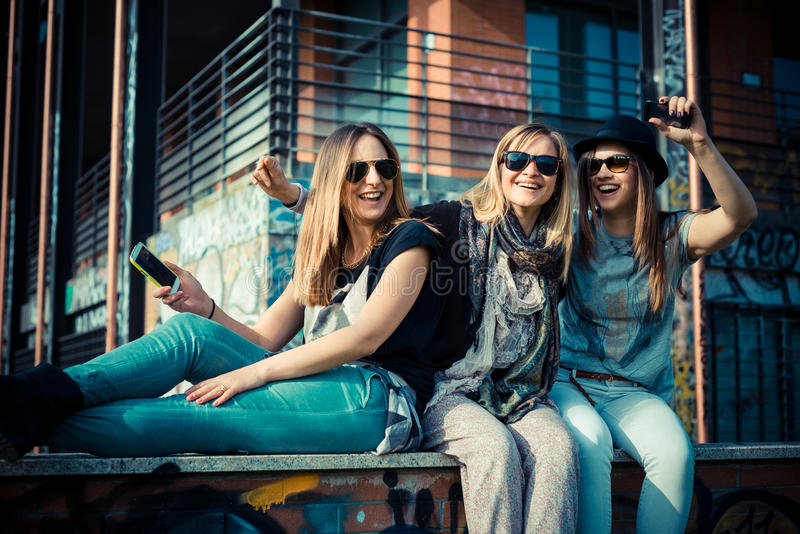 Three beautiful friends authentic. In urban contest royalty free stock photography