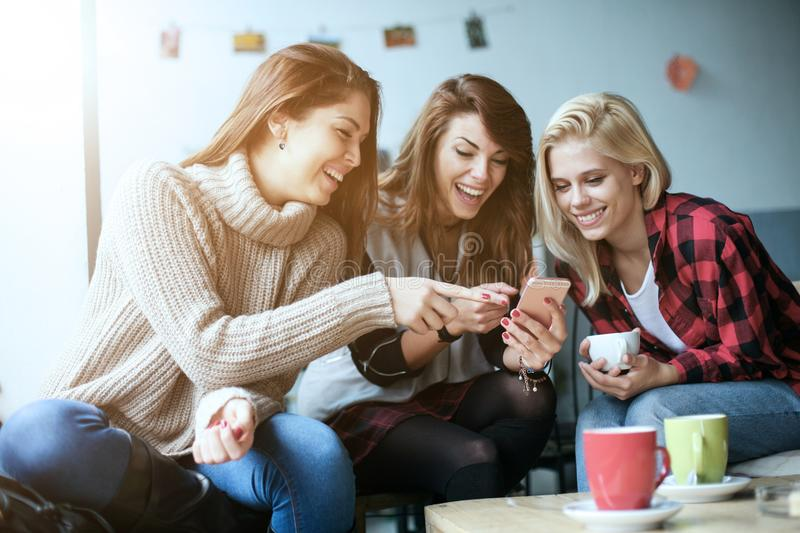 Friends in a cafe. stock image