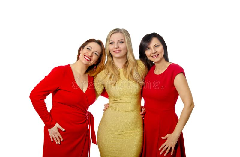 Three beautiful girlfriends in elegant dresses royalty free stock photo