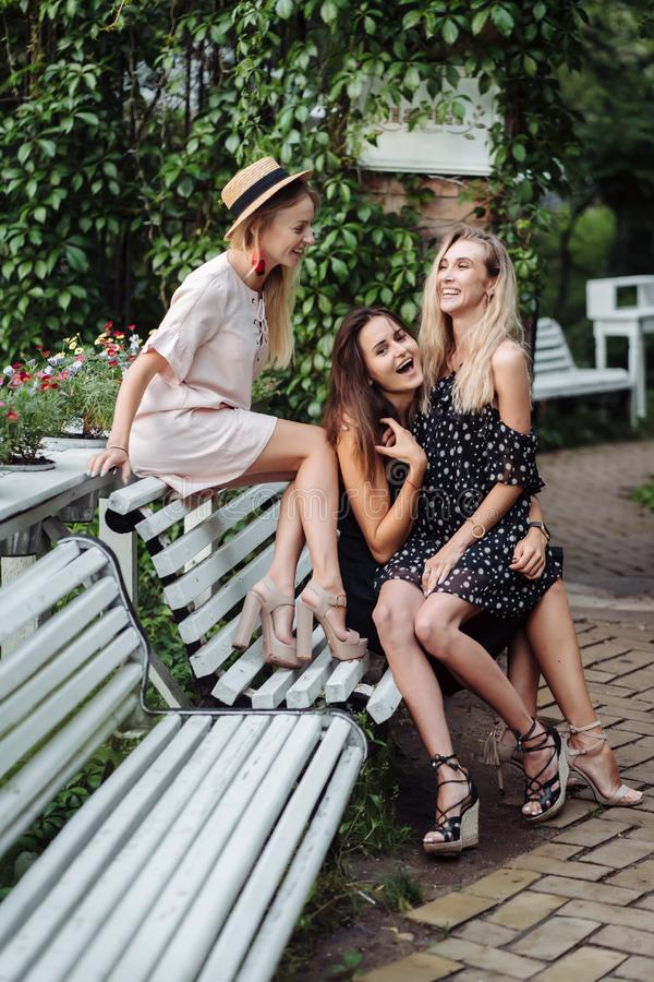 Three girls on the bench royalty free stock photo