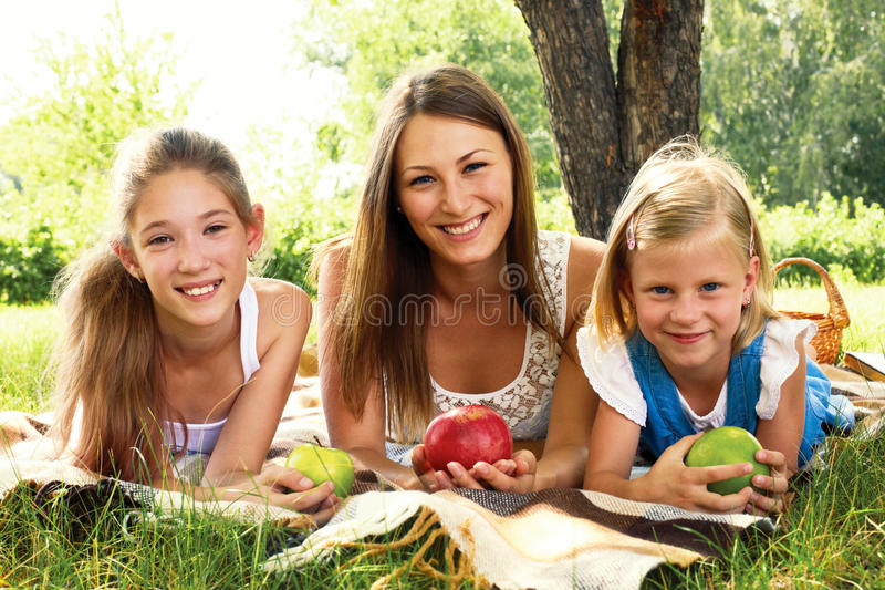 Three beautiful girls relaxing in park stock images