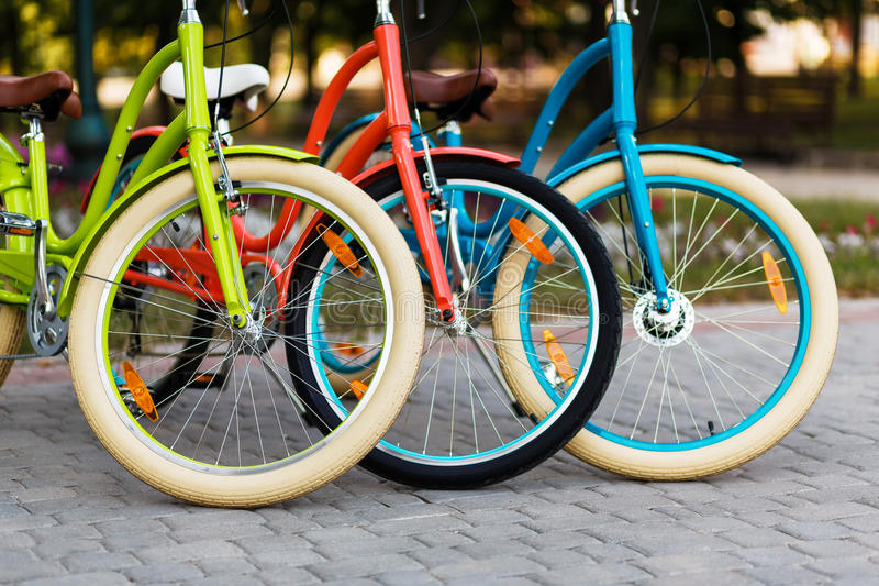 Three beautiful lady city bikes stock images