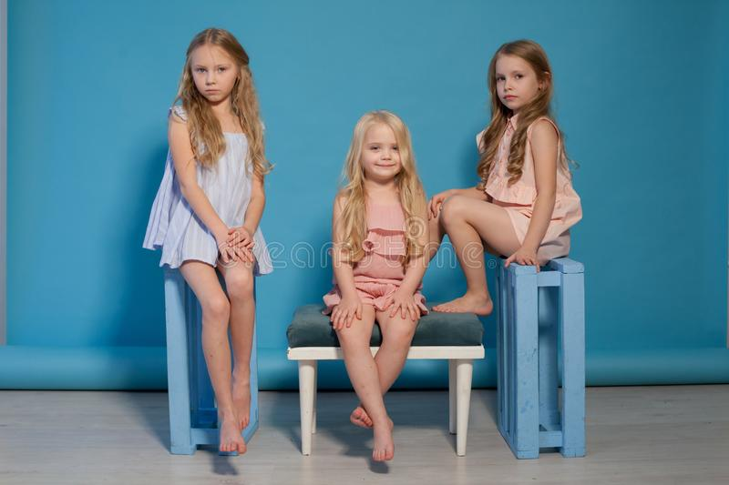 Three beautiful little girls dresses fashion portrait sisters royalty free stock photo