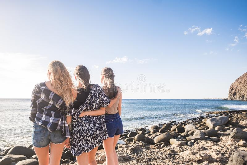Three Beautiful long hair young women in vacation. Young beautiful long hair women 25 years old in vacation outdoor in tenerife. Freedom and independence concept stock photo