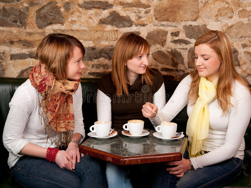 Three beautiful young students in bar stock photos
