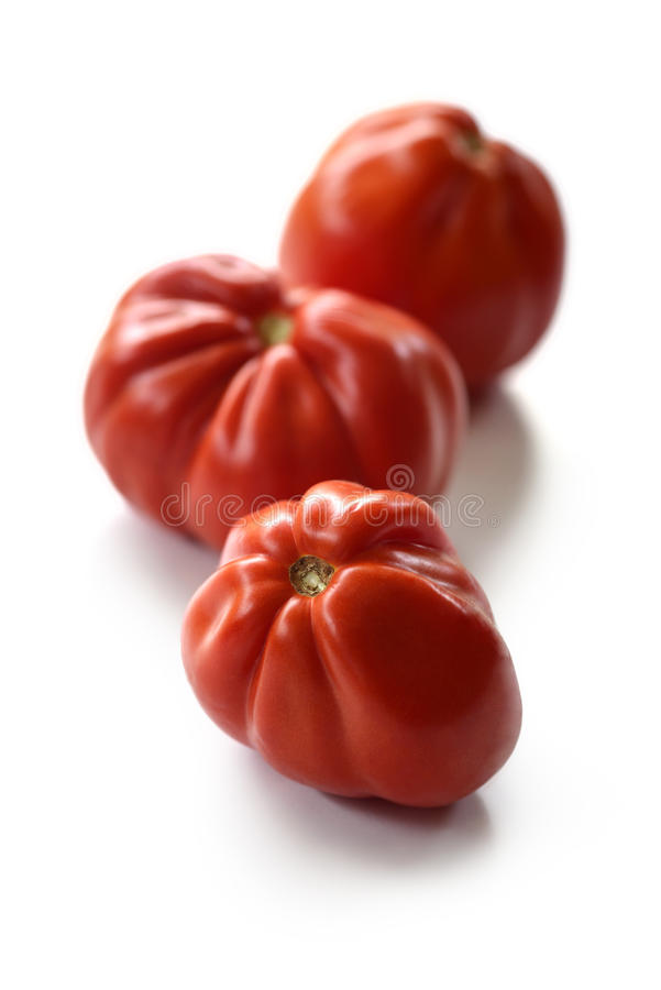 Three Beefsteak Tomatoes stock images