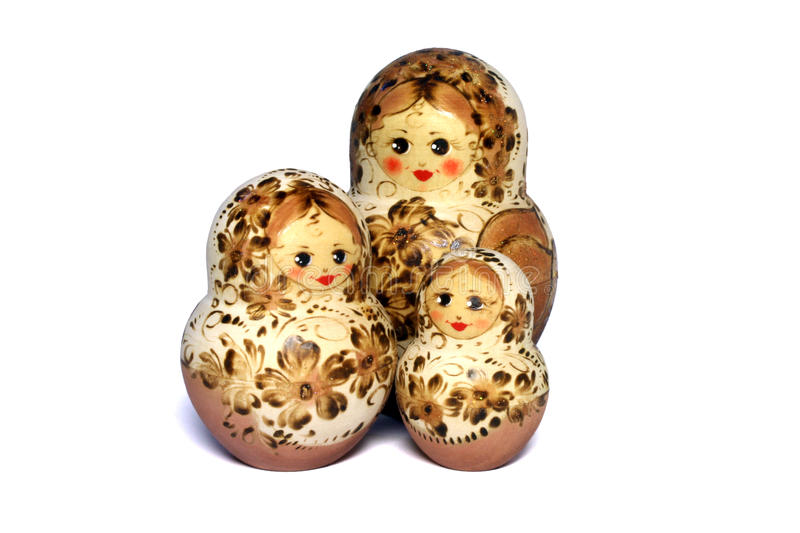 Three beige and brown matrioshkas stock image