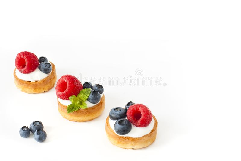 Belgian waffles with blueberry, raspberries and fresh mint on white background royalty free stock photography