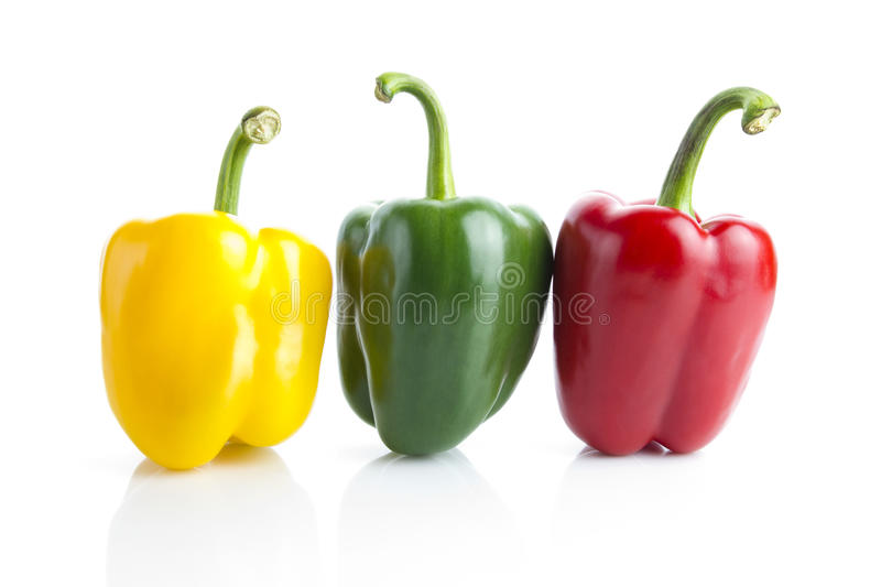 Three bell peppers. Three peppers isolated over white background royalty free stock photo