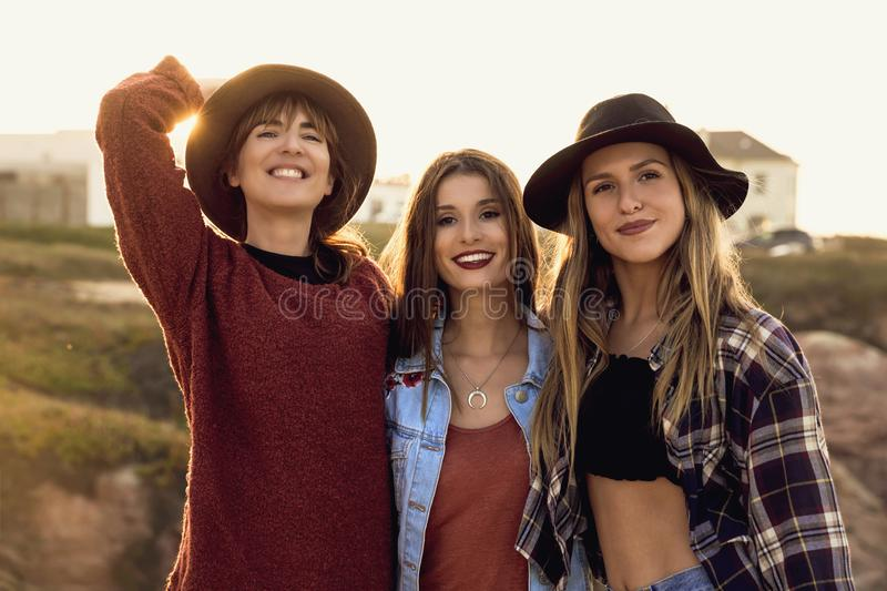 Best friends. Three best friends near the coastline having a good time royalty free stock images