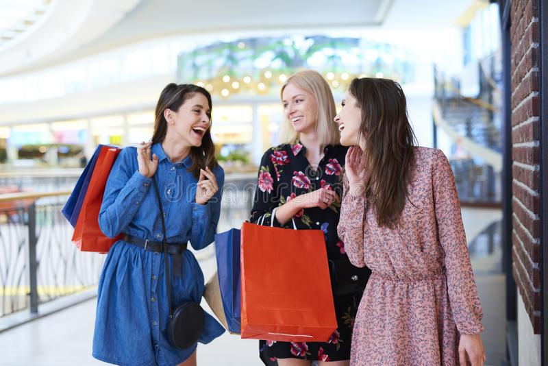 Three best friends at the shopping mall stock image