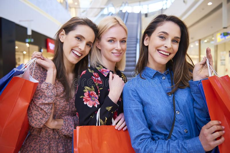 Three best friends during shopping royalty free stock photo
