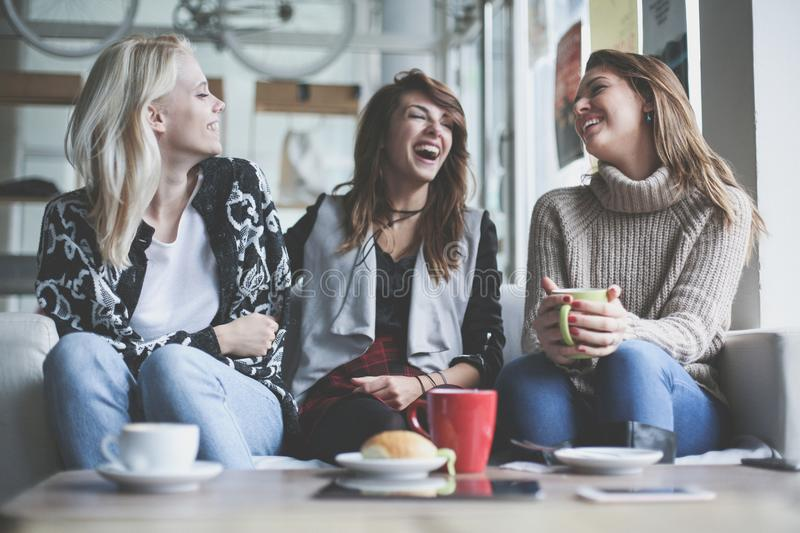 Three best friends. Young women having conversation. royalty free stock photos