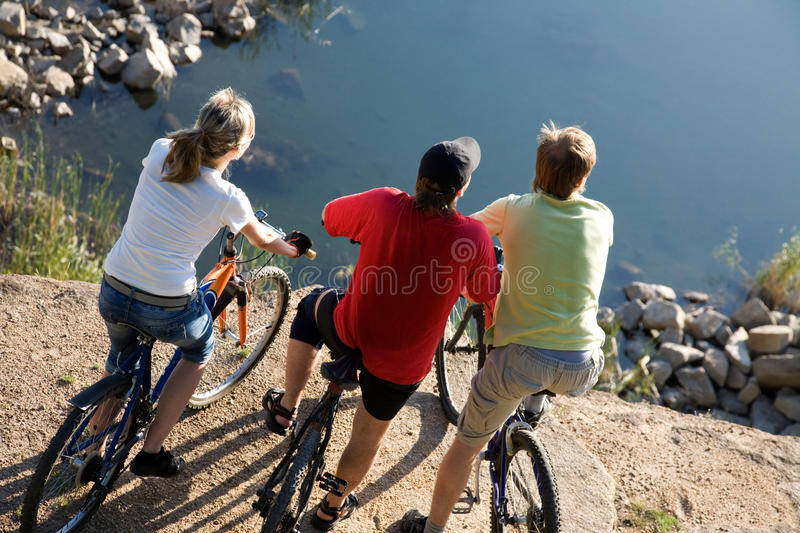 Three Bicyclists Stock Photography