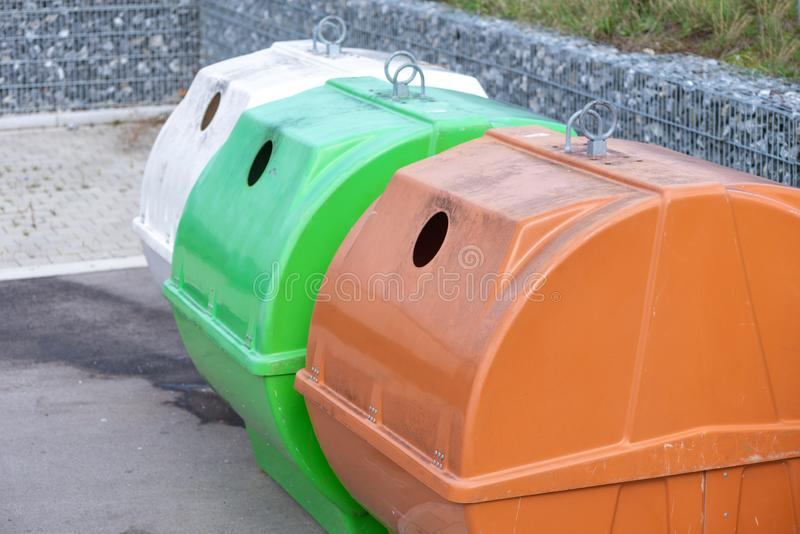Containers in different colors to collect recyclable waste stock photo