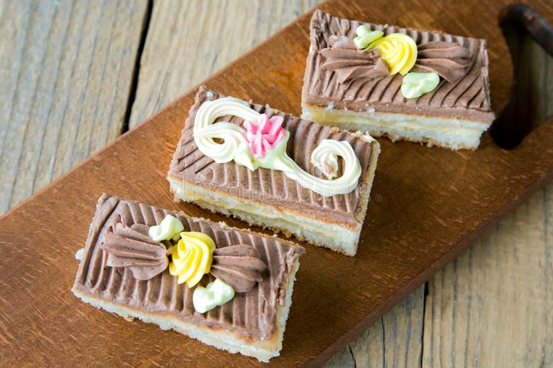 Three biscuit cakes on a close-up. Table stock images