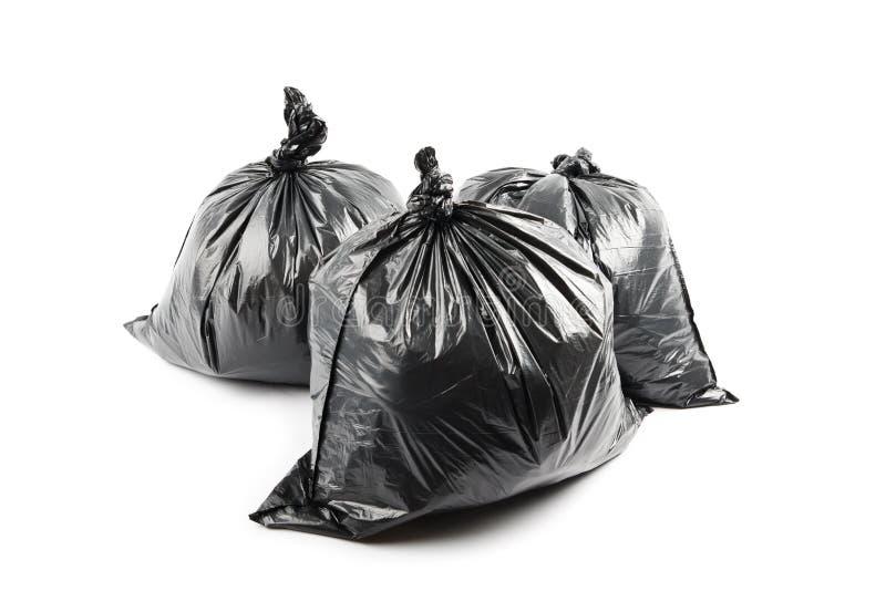 Three black garbage bags stock photo