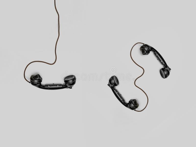 Three Black Handset Toys stock photo
