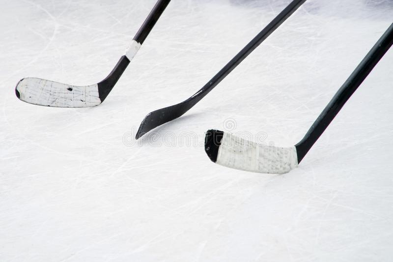 Three black ice hockey sticks on the court. Preparation for training in an open area royalty free stock photography