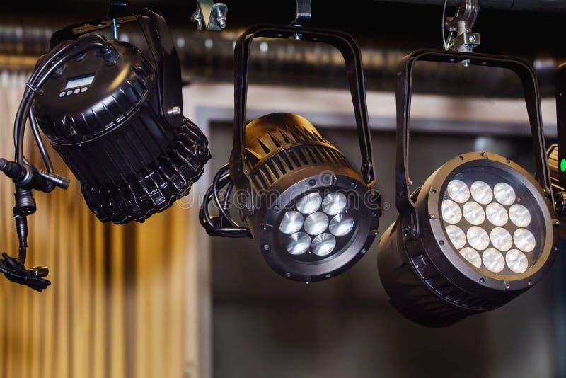 Three black spotlights on a stege. Close up royalty free stock photography