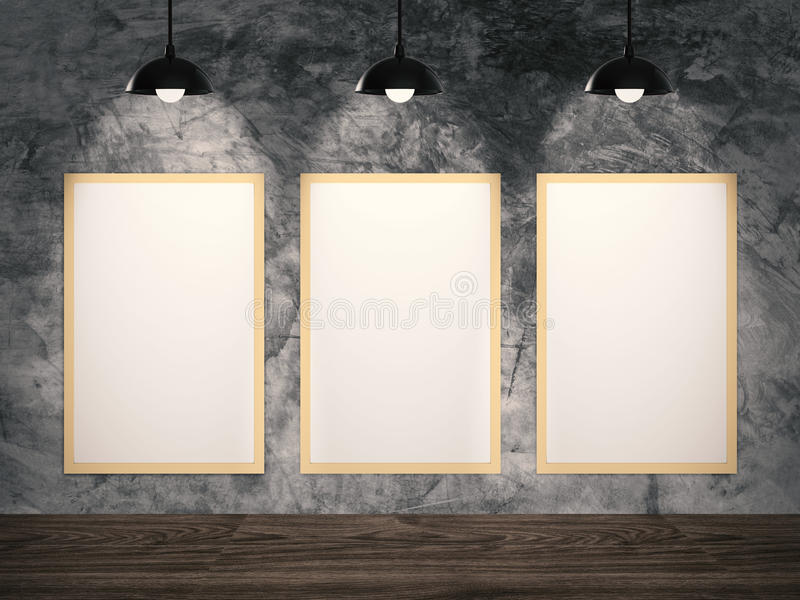 Three blank frames hanging. On cement wall royalty free stock image