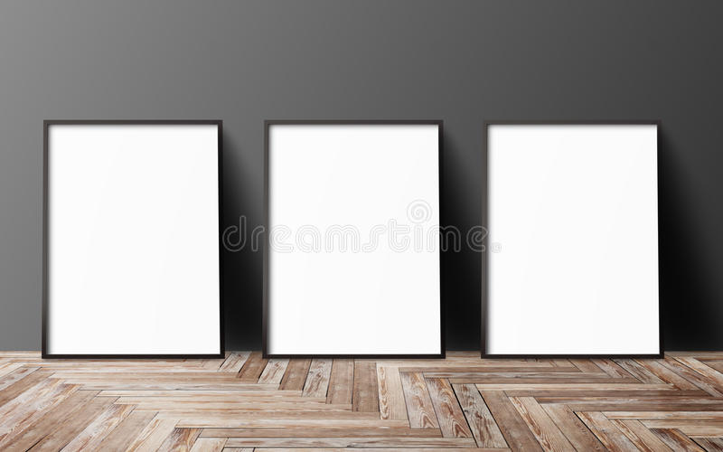 Three blank poster. Hanging on wall royalty free stock image