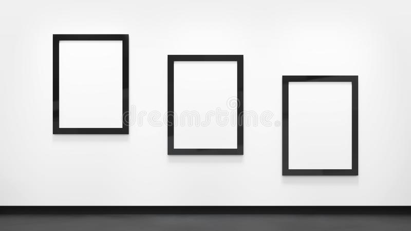 Three blank posters with black frames on the white wall. Picture gallery mockup royalty free stock photo