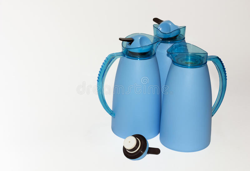 Three blue thermoses royalty free stock images