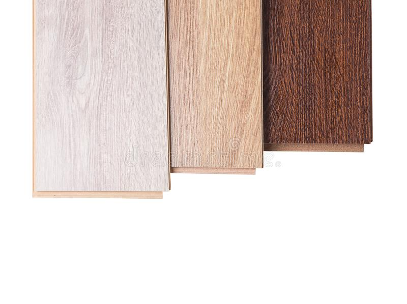 Three boards of laminate isolated on white. Three boards of laminate of different colors lie one on one in ascending order. Laminate isolated on white background stock images