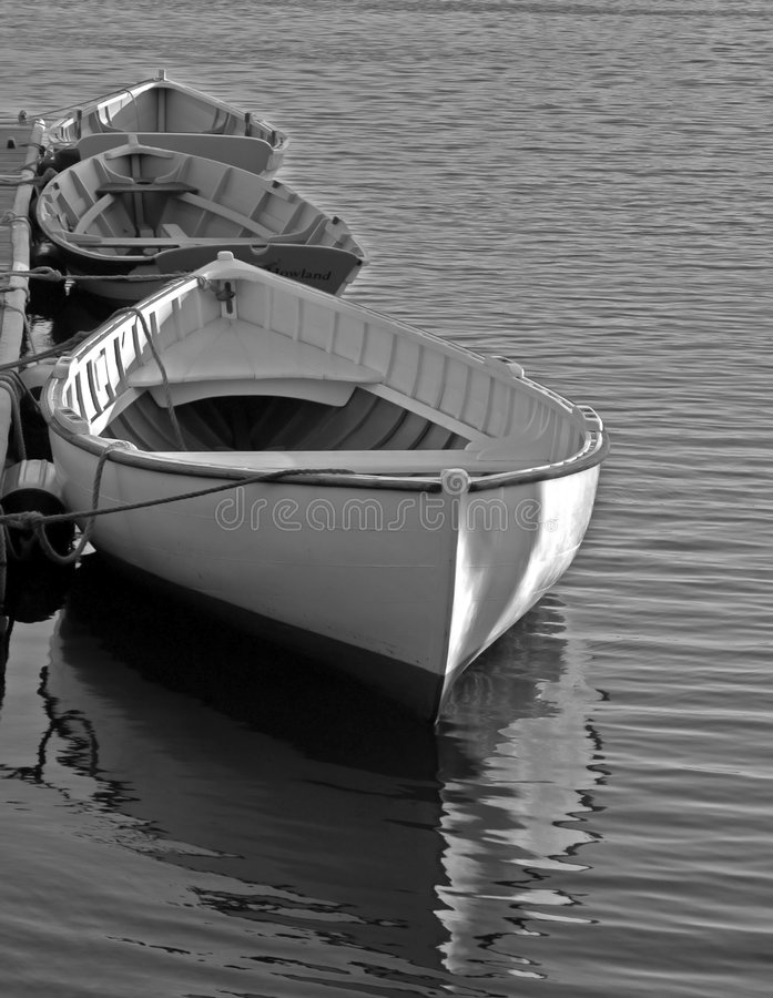 Three Boats in Mystic. Black and white photo of three boats moored on the Mysitic River in Connecticut stock photography