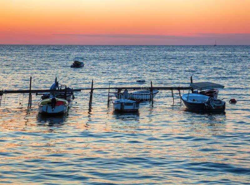 Three boats at sunset in Croatia. Three boats at sunset in Rovinj, Croatia stock image