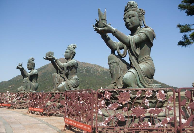 Three bodhisattva sculptures at the Po Lin Monastery, Lantau Island, Hong Kong, China. Color, daytime landscape photo of three bodhisattva sculptures at the Po stock photo