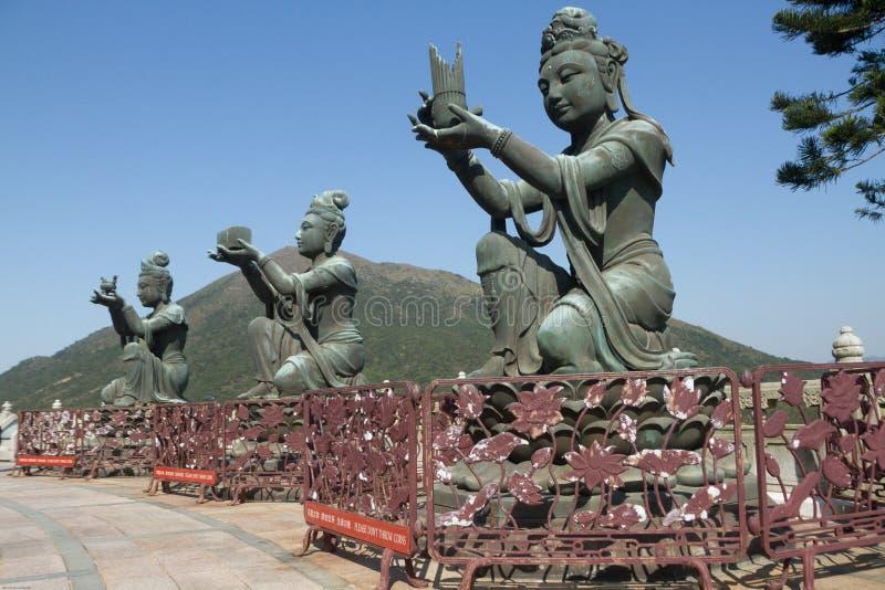 Three bodhisattva sculptures at the Po Lin Monastery, Lantau Island, Hong Kong, China. Color, daytime landscape photo of three bodhisattva sculptures at the Po royalty free stock photography