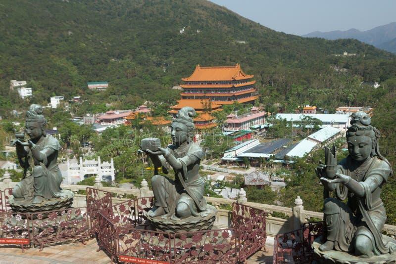 Three bodhisattva sculptures at the Po Lin Monastery, Lantau Island, Hong Kong, China. Color, daytime landscape photo of three bodhisattva sculptures at the Po stock photos