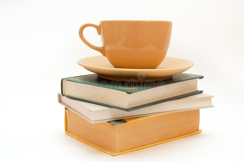 Three books and cup of tea/coffee royalty free stock photos