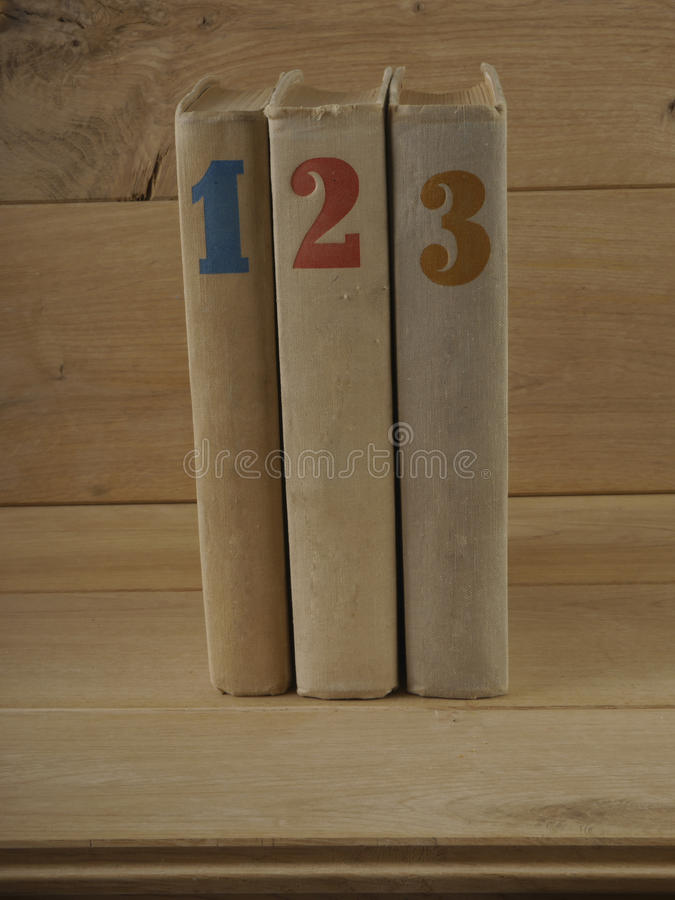 Three books. On wood backgraund closeup gray stock photos