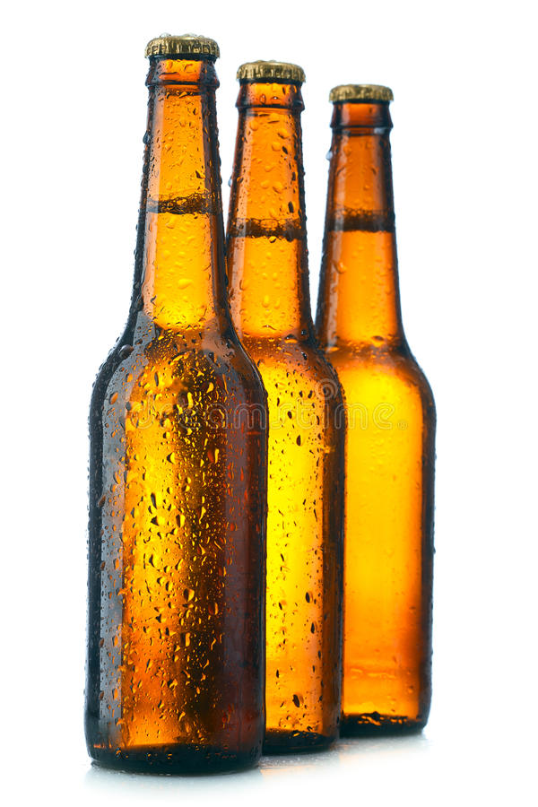 Three Bottle with beer. And drops on white background stock image