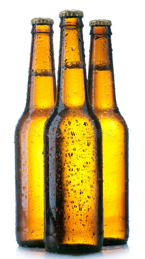 Three Bottle with beer and drops. On white background royalty free stock photos