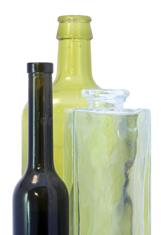 Three Bottles. Closeup view of three waste glass bottles against white background royalty free stock photography